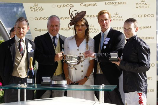 Winning owner Bjorn Nielsen with the Sandringham Stakes trophy with Ed Walker and Jamie Spencer. Photo: Steve Davies